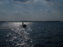 Silhouette of a jet ski Royalty Free Stock Images