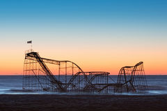 Silhouette of Jet Star Rollercoaster after hurricane Sandy. The iconic image of Jet Star Rollercoaster ride falling into the Atlantic Ocean post Super Storm Stock Photo