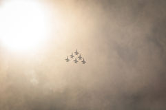 Silhouette of jets in clouds Royalty Free Stock Photography