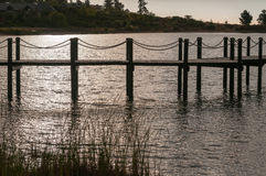 Silhouette of a jetty in a dam. Near Somerset West in the Western Cape Province of South Africa Royalty Free Stock Image
