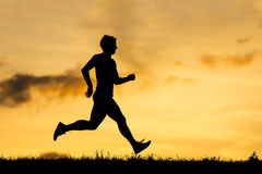 Silhouette of a jogger Royalty Free Stock Images