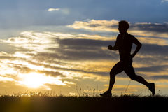 Silhouette of a jogger in sunrise Stock Images
