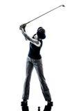 Silhouette jouante au golf de golfeur de femme Photographie stock