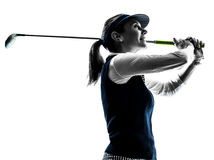 Silhouette jouante au golf de golfeur de femme Image libre de droits