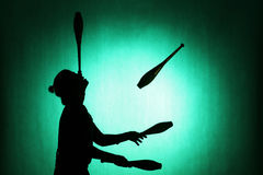 Silhouette of a juggler Royalty Free Stock Images