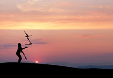 Silhouette of juggler in sunset Royalty Free Stock Images