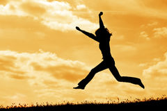 Silhouette jump. Silhouette of jumping  woman on the sky background Royalty Free Stock Images