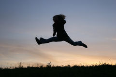Silhouette jump girl Royalty Free Stock Images