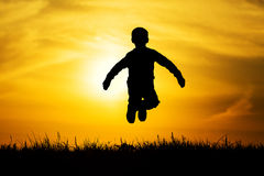 Silhouette jumped boy Royalty Free Stock Photography