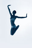 Silhouette of jumping blue ballerina Royalty Free Stock Photo