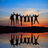 Silhouette of jumping friends Royalty Free Stock Photo