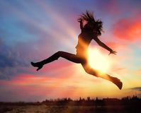 Silhouette of jumping girl Royalty Free Stock Photography