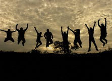 Silhouette - Jumping with Joy. Silhouette of Men jumping with Joy during sunset Royalty Free Stock Images