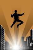 Silhouette of a jumping man Stock Images