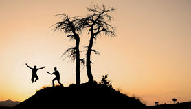 Silhouette of jumping man. Healthy and active people Stock Photography