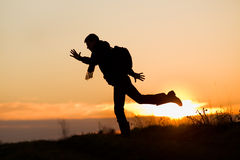 Silhouette of jumping man Stock Images