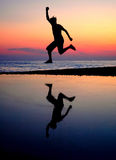 Silhouette jumping men Royalty Free Stock Image