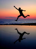 Silhouette jumping men Stock Photo