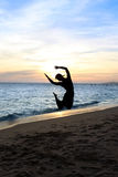 Silhouette jumping woman Royalty Free Stock Image