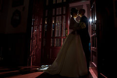 Silhouette of just married couple hugging. At home stock image
