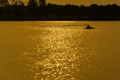 Silhouette of  Kayaking in Twilight time Royalty Free Stock Photos