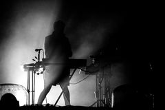 Silhouette of a keyboardist in stage lights Royalty Free Stock Photography