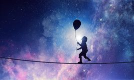 It is sweet night dream. Mixed media. Silhouette of kid boy with balloon against night starry sky. Mixed media Stock Images