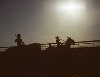 Silhouette Kids and Horses. Silhouette of Two young cowboys with their big cowboy hats on riding the range at Muleshoe, Texas Stock Image