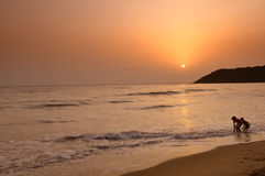 Silhouette of Kids Playing on the Beach. Kids playing on the beach near Goa in India Stock Photos