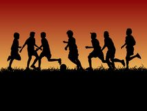 Set of silhouette kids playing football with evening background stock illustration