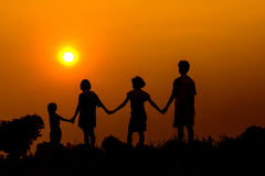 Silhouette of kids playing together with sunset Royalty Free Stock Images