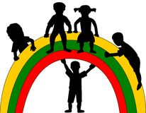 Silhouette of kids and rainbow Stock Image