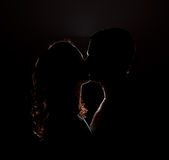 Silhouette of a kiss Stock Images