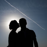 Silhouette of kissing couple. Girlfriend kissing her boyfriend Royalty Free Stock Photo