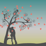 Silhouette of kissing couple Stock Images