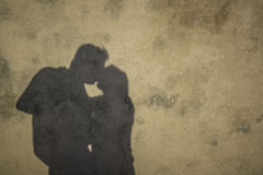 Silhouette of kissing couple. Romantic shadow on a wall of a kissing couple Royalty Free Stock Photo
