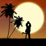 Silhouette kissing by sunset at the beach. Silhouette of a couple kissing near palm trees at the beach Royalty Free Stock Image