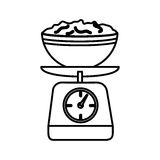 Silhouette kitchen weight scale with bowl and mixture Stock Images