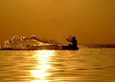 Silhouette of a kitesurf. On a gulf on a sunset Royalty Free Stock Photos