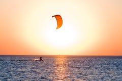Silhouette of a kitesurfer stock image