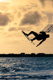 Silhouette of a kitesurfer flying Royalty Free Stock Photography