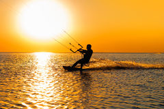 Silhouette of a kitesurfer Stock Photography