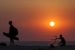Silhouette of a kitesurfer sailing at sunset Royalty Free Stock Photography