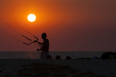 Silhouette of a kitesurfer sailing at sunset Royalty Free Stock Images