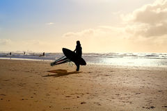 Silhouette of kitesurfer on sand beach Royalty Free Stock Photos