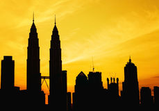 Silhouette of KLCC tower during golden sunrise Royalty Free Stock Image