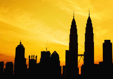 Silhouette of KLCC tower during golden sunrise Stock Image