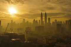Silhouette of Kuala Lumpur City during dramatic sunrise on hazy Stock Photography