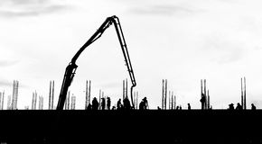 Silhouette labor working on building. Site Stock Images