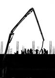 Silhouette labor working on building. Site Stock Photos